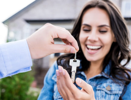 house buyer getting keys to new home